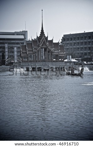Traditional Thai construction in city centre on lake. Blue tone