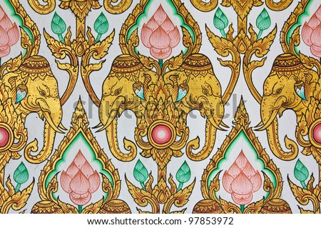 Traditional Thai elephant and lotus flower pattern design on wall in the temple - stock photo