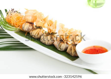 Traditional Thai food money bag or golden bag appetizers.  Shallow depth of field. - stock photo