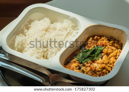 traditional thai food named pad kra pao in frozen food container - stock photo