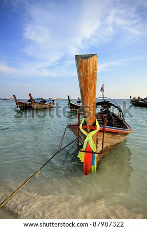 Traditional Thai Long-tail boat on the beach, at lipe island.