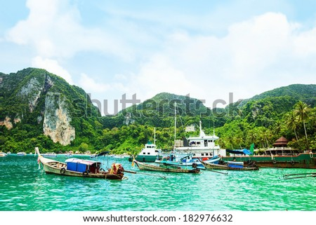 Traditional Thai long-tail boat on the beach of Phi Phi, Thailand - stock photo