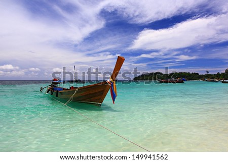 Traditional Thai Long-tail boat on the Lipe beach, at lipe island. Satun Province Thailand.