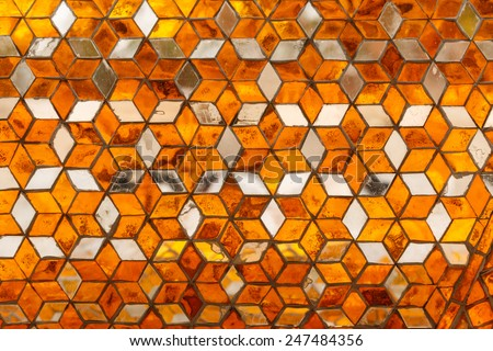 Traditional Thai style art mirror pattern on wall in Temple, Thailand - stock photo