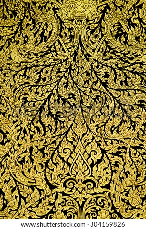 Traditional Thai style art of pattern on the door in temple, Thailand - stock photo