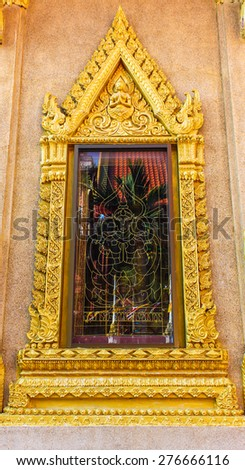 Traditional Thai style Buddhist temple window - stock photo