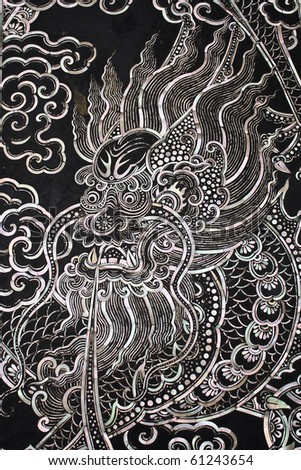Traditional Thai style church door art with chiness dragon - stock photo