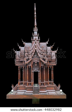 Traditional Thai style model house wood carving isolated on black background. Saved with clipping path