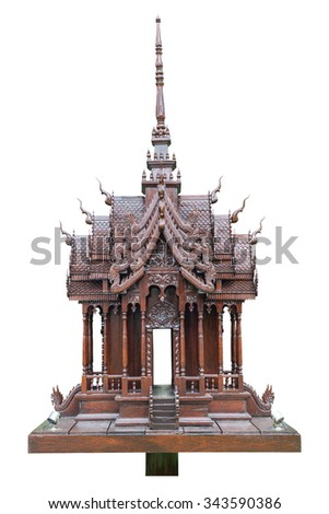 Traditional Thai style model house wood carving isolated on white background - stock photo