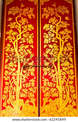 traditional thai style painting on temple door - stock photo