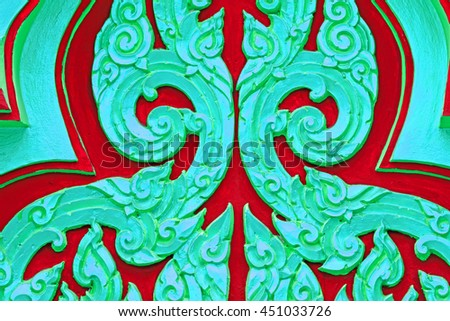 Traditional Thai style stucco on the wall of church in temple, Thailand. - stock photo