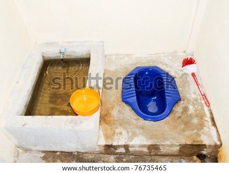 Traditional Thai toilet in the countryside of Thailand. - stock photo