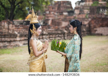 Traditional Thai Woman at a Buddhist Temple - stock photo