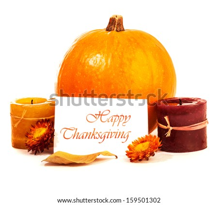 Traditional Thanksgiving day decoration isolated on white background, yellow gourd with candles and greeting card, autumn harvest holiday - stock photo