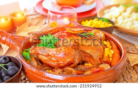 Traditional Thanksgiving family dinner with tasty grilled turkey in centerpiece of festive table, many delicious food for traditional autumn holiday - stock photo