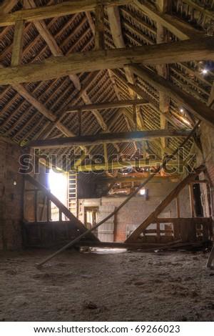 Traditional timber framed English barn interior.