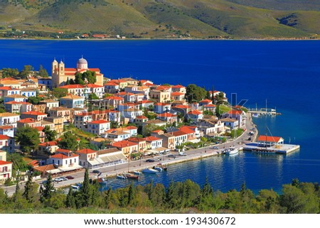 Traditional town surrounded by blue sea, Greece - stock photo