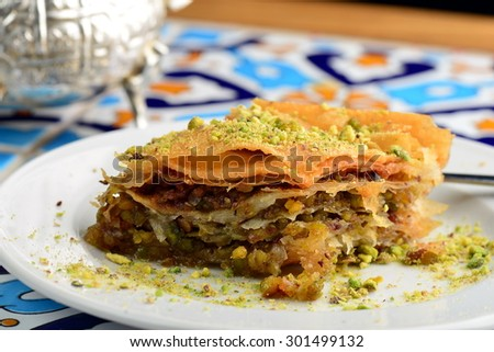 traditional Turkish arabic dessert - baklava with honey and pistachios - stock photo