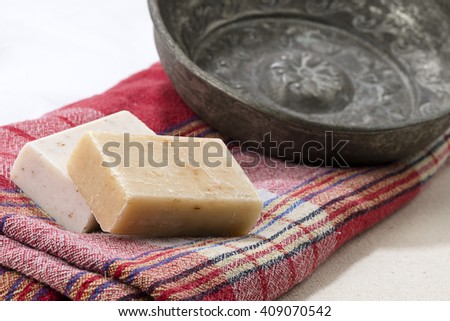 Traditional Turkish bath objects bath bowl, soap and pestemal.  - stock photo