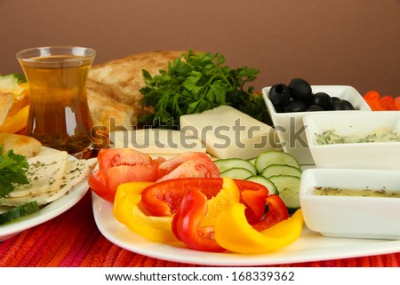 Traditional Turkish breakfast on table on brown background
