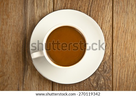 Traditional Turkish Coffee cup and coffee beans concept with wooden background