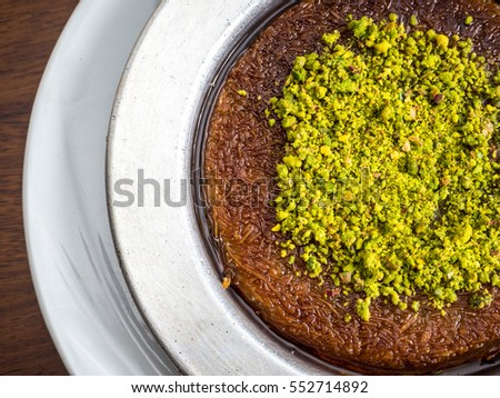 Traditional Turkish Dessert Kunefe served with pistachio