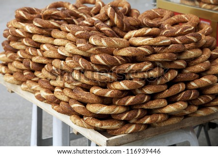 Traditional turkish street food, pretzels with sesame - stock photo