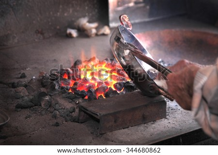 Traditional Turkish tinsmith or coppersmith - stock photo