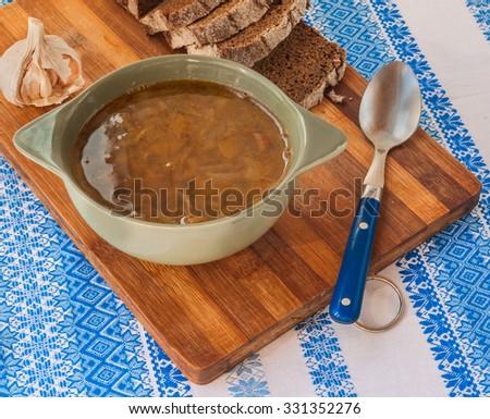 Traditional Ukrainian cuisine food pumpkin soup with mushrooms - stock photo