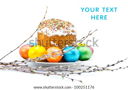Traditional Ukrainian Easter cake with painted eggs on a plate and pussy willow, isolated on a white background - stock photo