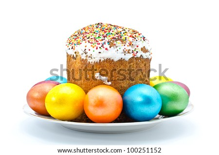 Traditional Ukrainian Easter cake with painted eggs on the plate, isolated on a white background - stock photo