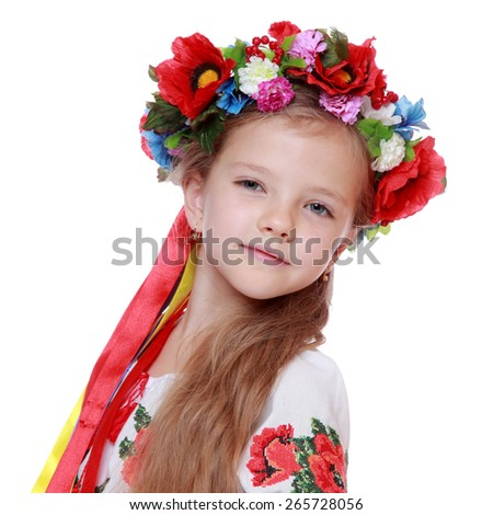 Traditional Ukrainian little girl from east Europe/Emotional little girl in a beautiful Ukrainian costume on a white background