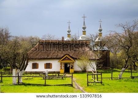 Traditional ukrainian rural house. Spring, - stock photo
