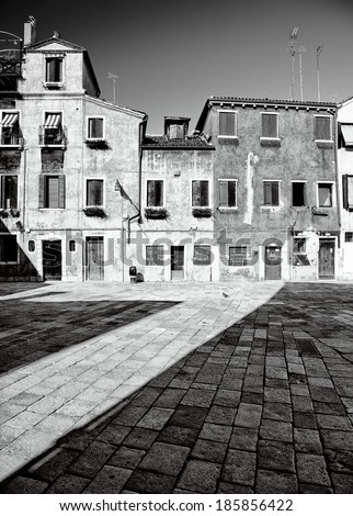 Traditional Venetian houses and yard in black and white, Venice, Italy - stock photo