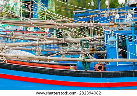 Traditional vietnamese blue and red fishing boat shot closeup.