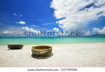 Traditional Vietnamese boats on the beach. - stock photo