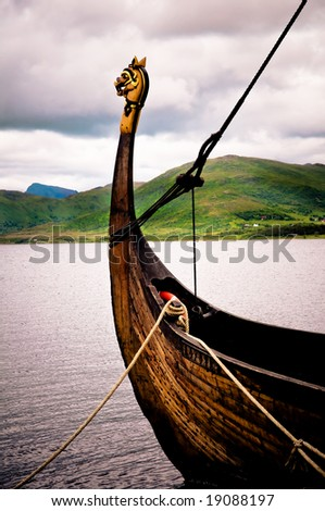 Traditional viking boat in the north of Norway - stock photo