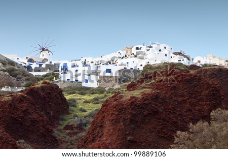 Traditional village of Oia at Santorini island in Greece. View from the port of Amoudi. - stock photo