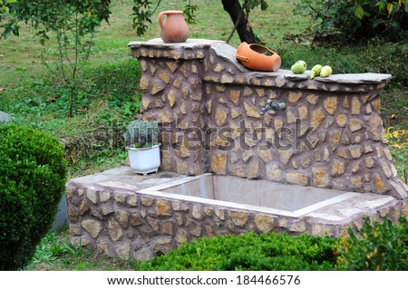 Traditional washbasin in the garden in Bulgaria - stock photo
