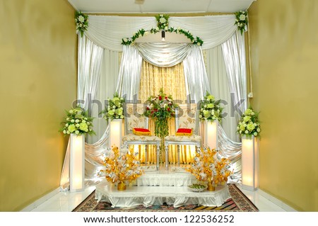 traditional wedding stage with yellow decoration - stock photo
