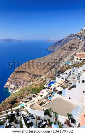 Traditional white houses of Santorini village and spectacular view to volcanic bay, Greece - stock photo