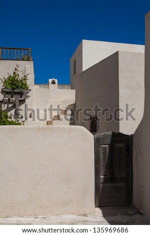 Traditional white village houses on the background of blue sky,Santorini, Greece