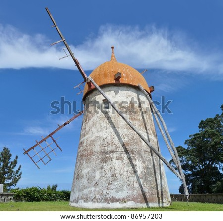 traditional windmill at Sao Miguel Island, the biggest island of the Azores Archipelago, wich is a group of vulcanic islands located in the middle of the North Atlantic Ocean (Portugal) - stock photo