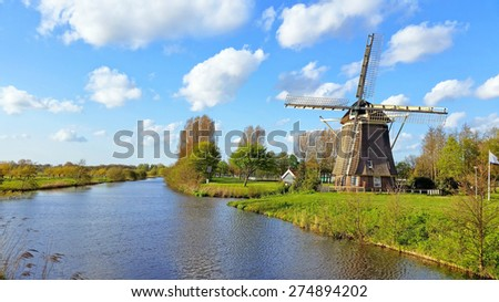 Traditional windmill in the countryside near Amsterdam Netherlands - stock photo