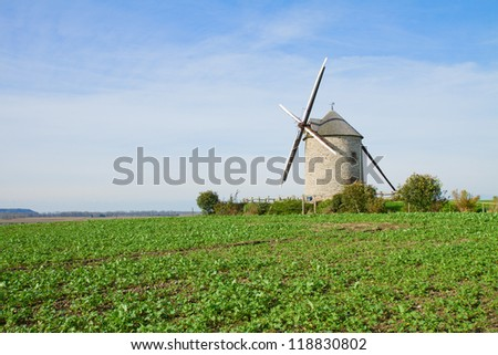 Traditional windmill in the vicinity of Mont Saint Michel monastery in Base Normandy in France - stock photo