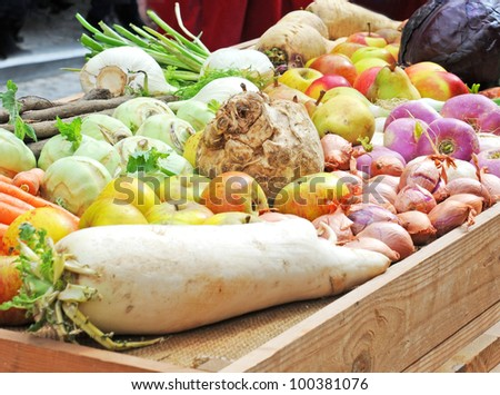 Traditional winter fruit and vegetables on wooden tray - stock photo