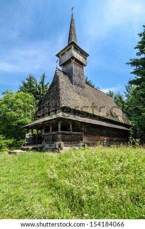 Traditional wood church from Maramures, Romania. Romanian traditional architectural style, life in the countryside. - stock photo
