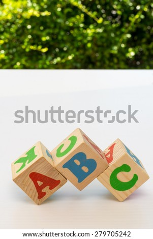 Traditional Wooden Alphabet blocks with letters ABC - stock photo