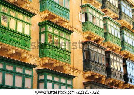 Traditional wooden balconies in Valletta, Malta - stock photo