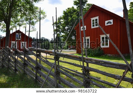 Traditional wooden houses in the Scandinavian village. Aland Islands - stock photo